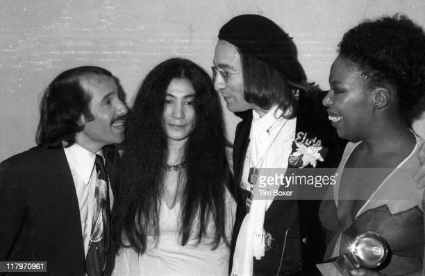From left American musician Paul Simon Japanese American musician Yoko Ono her husband British musician John Lennon and American musician Roberta...