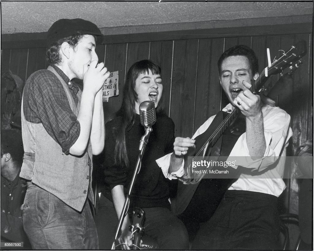 From left, American musicians Bob Dylan (born Robert Zimmerman), Karen Dalton (1938 - 1993), and Fred Neil (1936 - 2001) perform at Cafe Wha? on MacDougal Street, New York, New York, February 6, 1961.