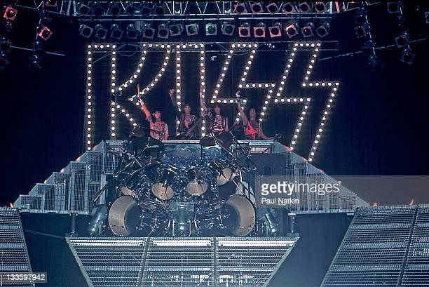 From left American musicians Eric Carr Gene Simmons Bruce Kulick and Paul Stanley of the group Kiss wave from the stage at the Mecca Arena Milwaukee...