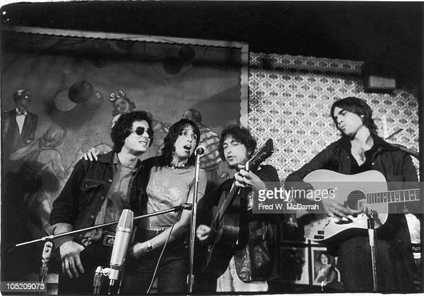 From left American musicians Rob Stoner Joan Baez Bob Dylan and Eric Andersen perform on stage at Gerde's Folk City 130 West 3rd Street New York...