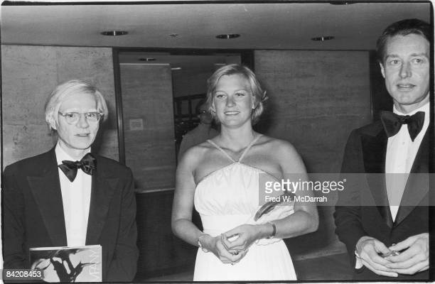 From left American pop artist Andy Warhol author Susan Ford and fashion designer Halston pose togather at the Four Seasons restaurant for a Martha...