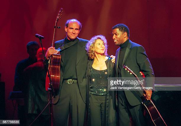 From left American Pop musicians James Taylor and Carole King and RB musician Babyface take a bow after their performance in the Theater at Madison...