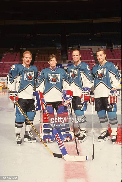From left American professional hockey players Brian Leetch and Mike Richter pose on the ice with fellow New York Rangers teammates members of the...