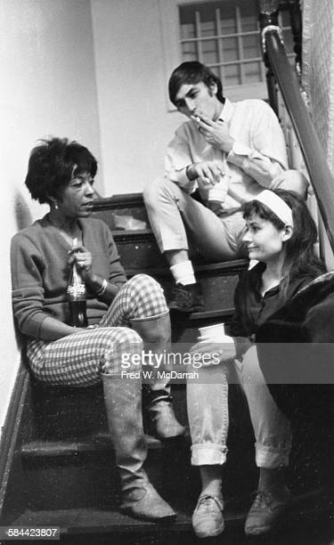 From left American theatre director Ellen Stewart playwright Lanford Wilson and actress Claris Nelson sit on a staircase at La MaMa ETC New York New...