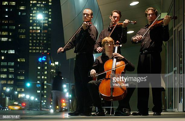 From left Andrew Bulbrook Eric Byers Benjamin Jacobson and Jonathan Moerschel of the Calder Quartet stand outside Disney Hall in Downtown Los Angeles...