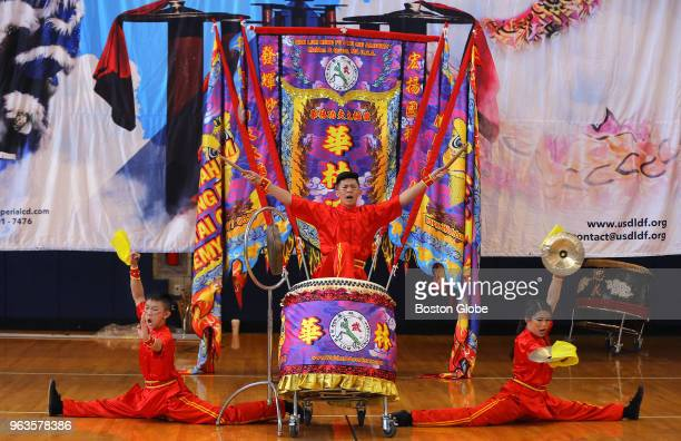 From left Andrew Nguyen Joshua Chinfatt and Emmy Chinfatt finish their drumming routine with a flair during a drumming competition at Quincy High...