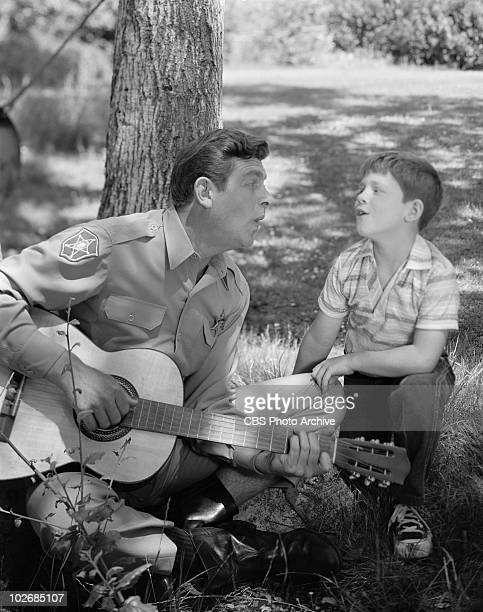 Andy Griffith as Sheriff Andy Taylor and Ron Howard as 'Opie' Taylor Image dated August 30 1962