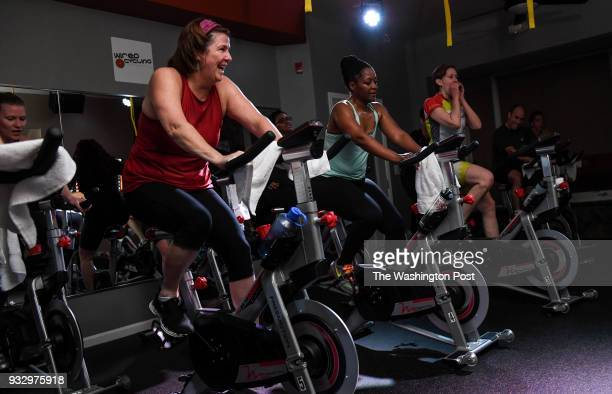 From left Anne Grenaldo Margo Bailey and Stacey Wagner take part in a cycling class at Wired Cycling a boutique fitness studio in Northeast...