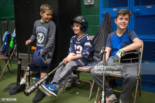From left Anthony Rinaldi Cameron Damon and Thomas Lewis wait to practice at the batting cages in the Westbrook Community Center Their little league...