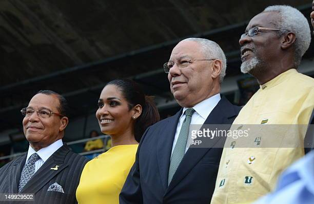 From left are Minister Louis Farrakhan of the US Lisa Hanna Jamaican Minister of Youth and Culture former US Secretary of State Colin Powell and...