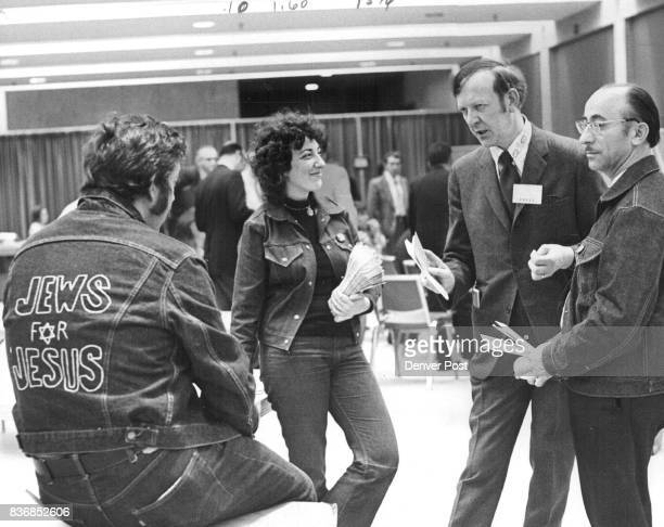 From left are Moishe Rosen and Jean Emma at right is Eliezer Urbach The three talk with unidentified man at recent meeting of American Baptist...