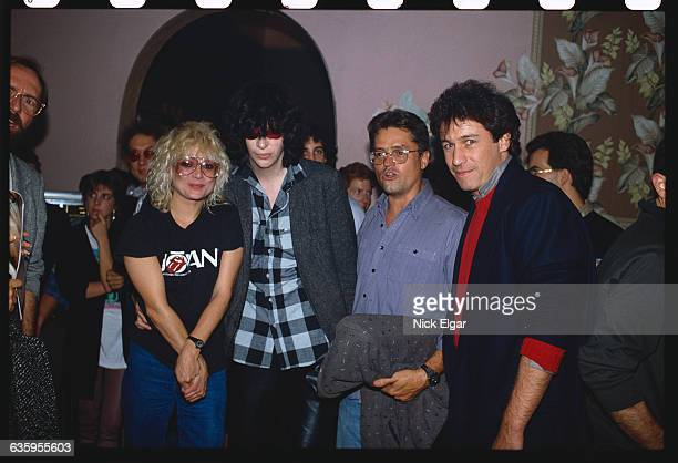 From left are MTV VJ Nina Blackwood singer Joey Ramone and director Jonathan Demme