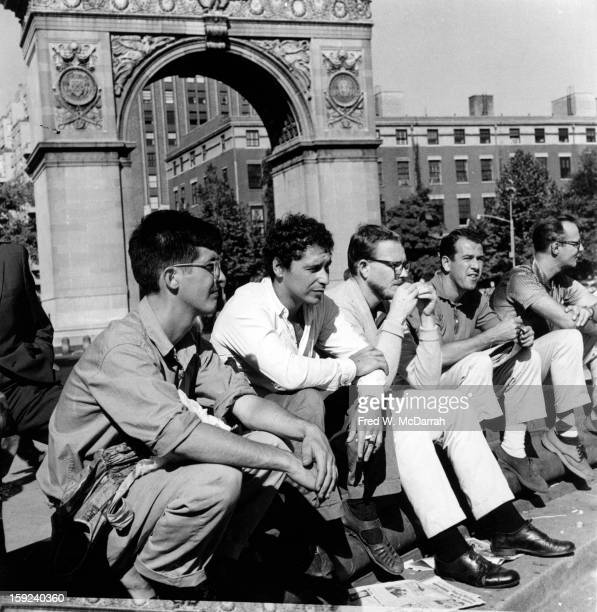 From left art dealer Richard Bellamy American filmmaker and painter Alfred Leslie and unidentified others sit together on a bench in Washington...