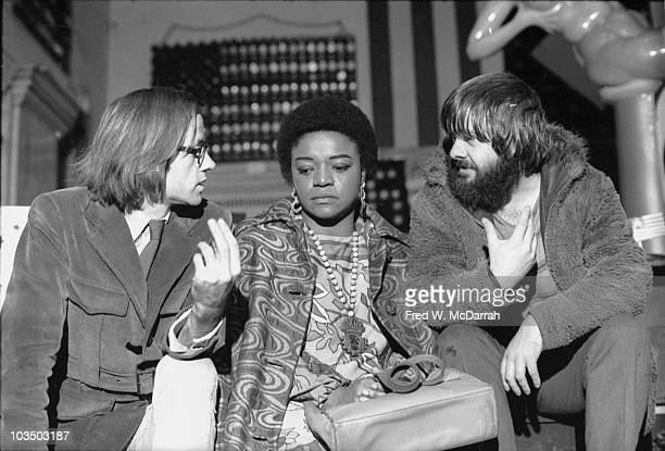 From left artists Jon Hendricks Faith Ringgold and Jon Toche talk together at the People's Flag Show at Judson Church New York New York Novermber 15...