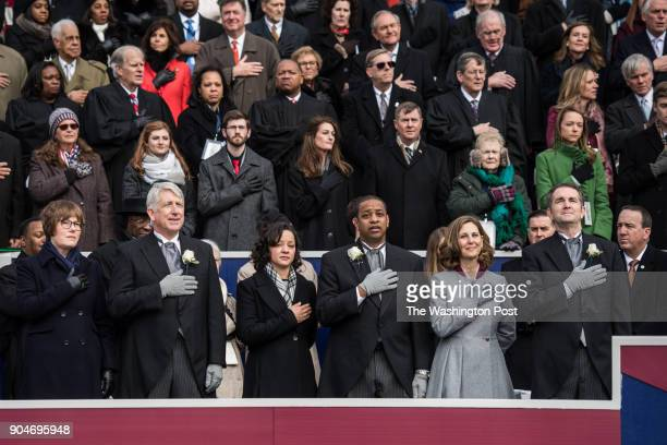 From left Attorney Elect General Mark Herring and his wife Lt Gov Justin Fairfax and his wife and Gov Ralph Northam and his wife Pam Northam during...
