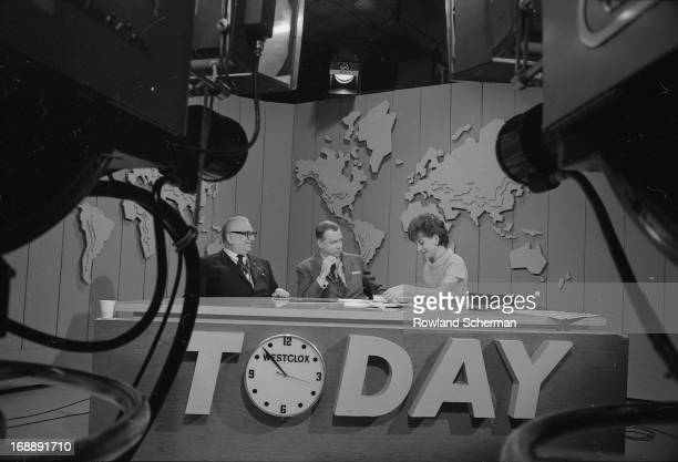 From left, author Harry Golden , and broadcast journalists Hugh Downs and Barbara Walters talk at the desk on the set of the 'Today' show during...
