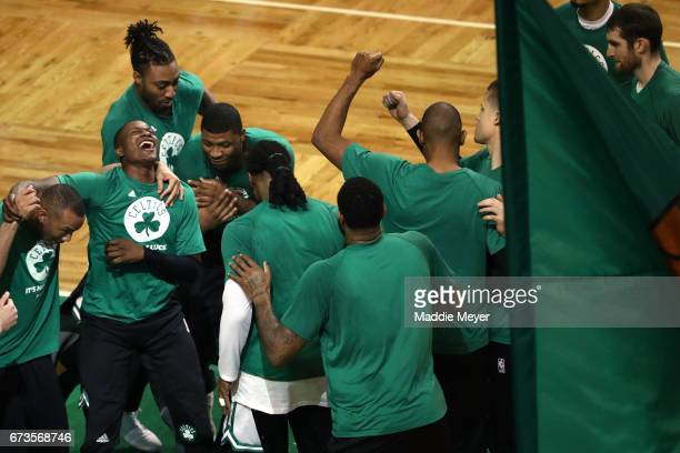 From left Avery Bradley Terry Rozier James Young and Marcus Smart of the Boston Celtics celebrate with teammates before the start of Game Five of the...