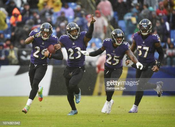 From left Baltimore Ravens' Marlon Humphrey celebrates with teammates Tony Jefferson Tavon Young and CJ Mosley after intercepting a pass by Tampa Bay...