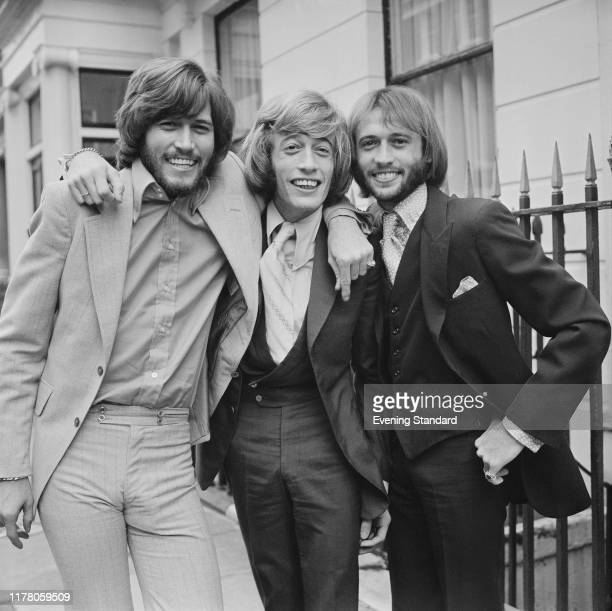 From left Barry Gibb Robin Gibb and Maurice Gibb of pop group Bee Gees posed together in London on 4th September 1970