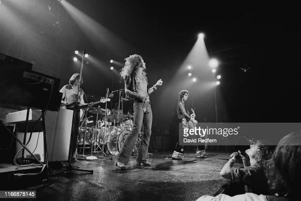 From left, bassist John Paul Jones, drummer John Bonham, singer Robert Plant and guitarist Jimmy Page perform live on stage during a concert by...