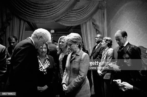 From left Bill Clinton Dorothy Rodham Chelsea Clinton and Hillary Clinton confer in a holding room before the Pennsylvania night rally at the Park...