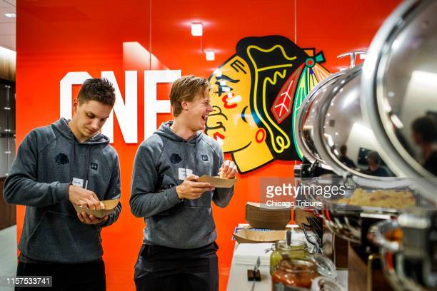 From left Blackhawks prospects Jakub Galvas and Adam Boqvist attend a nutrition and cooking class in the Blackhawks' kitchen at the Fifth Third Arena...