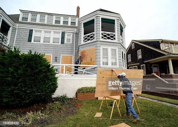From left, Bob Grabenstetter and Mike Kern board up the Mae West hotel in preparation for Hurricane Sandy October 27, 2012 in Cape May, New Jersey....