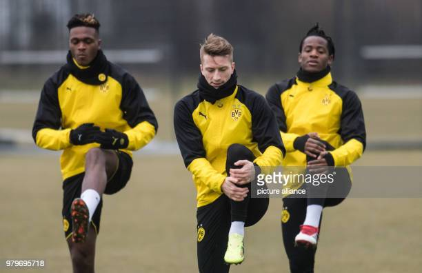 Borussia Dortmund's DanAxel Zagadou Marco Reus and Michy Batshuayi warm up during a training session ahead of Thursday's UEFA Europa League round of...