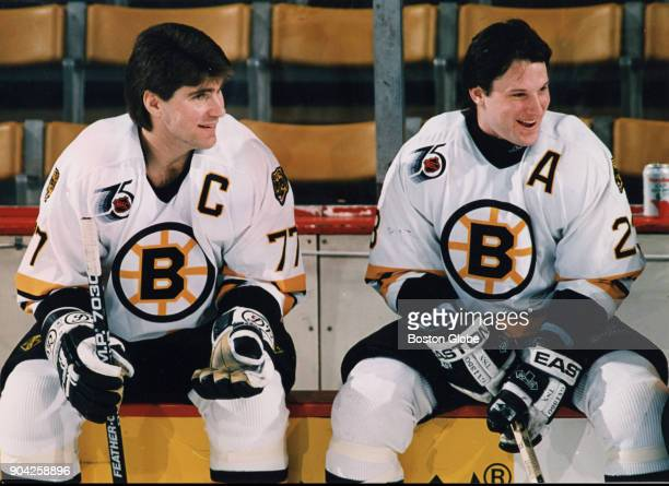 From left Boston Bruins Ray Bourque left and Craig Janney right talk during the Boston Bruins/Coca Cola classic skills challenge to benefit the I...