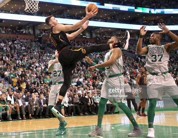 From left Boston Celtics Daniel Theis Greg Monroe and Semi Ojeleye watch as Cleveland Cavaliers Larry Nance Jr attempts a acrobatic layup during...