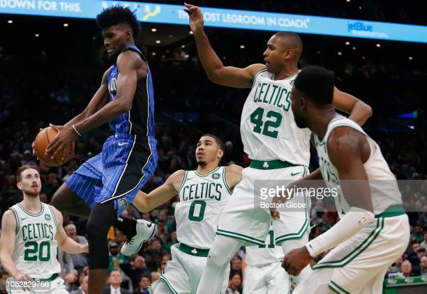 From left Boston Celtics' Gordon Hayward Jayson Tatum and Al Horford guard against the Magic's Jonathan Isaac during the second half The Boston...