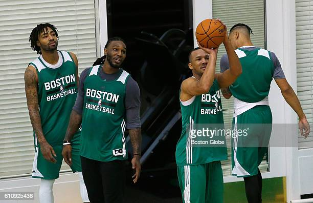 From left Boston Celtics players James Young and Jae Crowder watched as Avery Bradley lined up a three point shot during Celtics practice in Waltham...