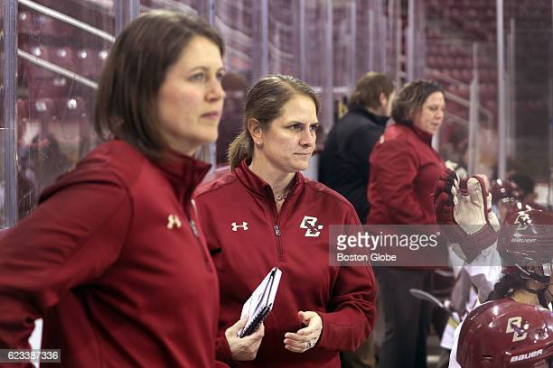 From left Boston College Eagles women's hockey assistant coach Gillian Apps head coach Katie Crowley and assistant coach Courtney Kennedy stand on...