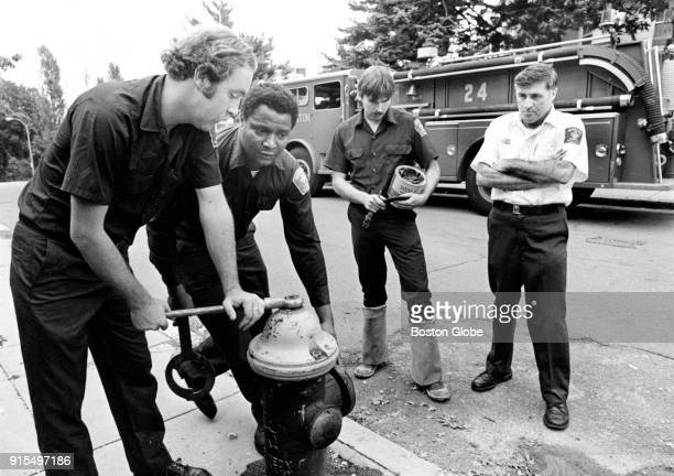From left Boston firefighters Charlie Buchanan Bob Graham Donald Starrow and Captain James McCabe make a service inspection of a fire hydrant on...