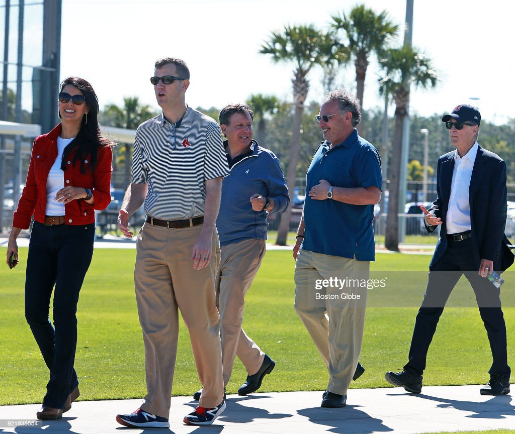 From left, Boston Red Sox executives Linda Pizzuti Henry, Sam Kennedy, Tom Werner, David Ginsberg and John Henry are walk to the playing fields to observe on the day of the first full squad spring training workout at the Player Development Complex at Jet Blue Park in Fort Myers, FL on Feb. 19, 2018.