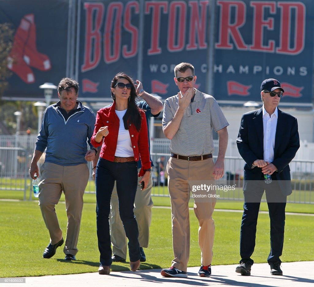 From left, Boston Red Sox executives Tom Werner, Linda Pizzuti Henry, Sam Kennedy and John Henry walk to the playing fields to observe on the day of the first full squad spring training workout at the Player Development Complex at Jet Blue Park in Fort Myers, FL on Feb. 19, 2018.