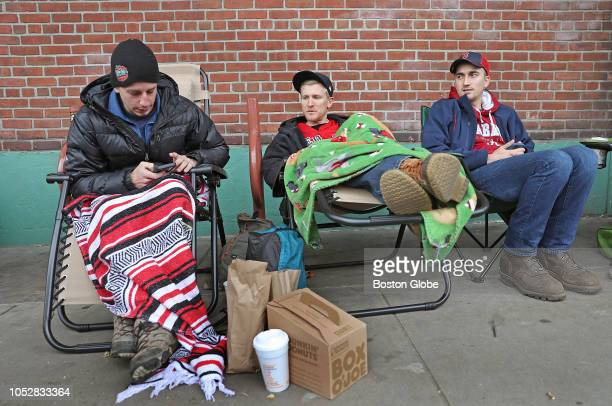 From left Boston Red Sox fans David Martin of Boston Andrew Fuller of Maine and Austin Wheeler of Greenfield wait in line for lastminute tickets for...