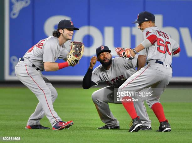 From left Boston Red Sox outfielders Andrew Benintendi Jackie Bradley and Mookie Betts celebrate a 90 win against the Baltimore Orioles at Oriole...