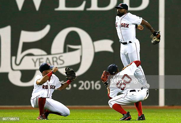 From left Boston Red Sox outfielders Chris Young Mookie Betts and Jackie Bradley Jr celebrate their win against the New York Yankees at the...