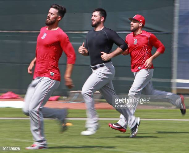 From left Boston Red Sox pitchers Rick Porcello Brandon Workman and Matt Barnes get in some sprinting at the end of practice on the final day of...