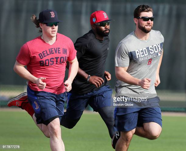 From left Boston Red Sox players Brock Holt Jackie Bradley Jr and Sam Travis sprint around the bases during spring training at the Player Development...