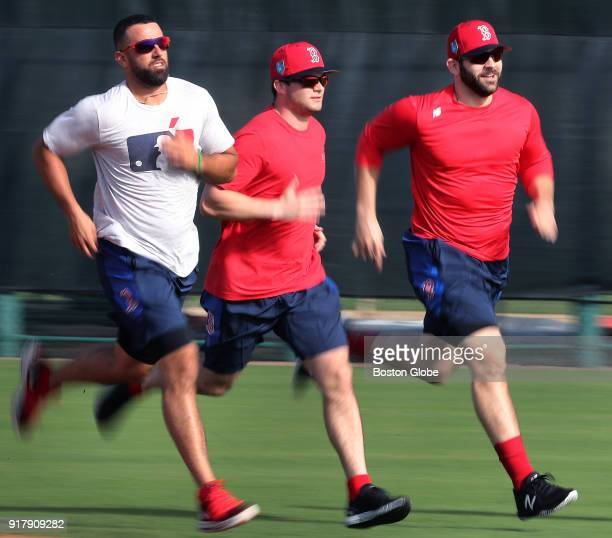 From left Boston Red Sox players Deven Marrero Andrew Benintendi and Mitch Moreland sprint around the bases during spring training at the Player...