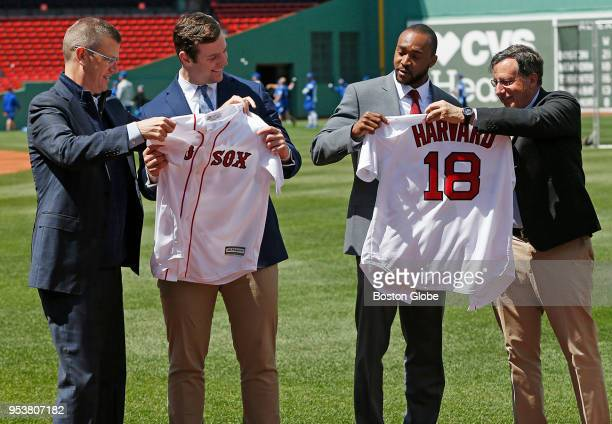 From left Boston Red Sox President Sam Kennedy presents Yale Football Captain Kyle Mullen with a Red Sox jersey as Harvard Football Captain Zach...
