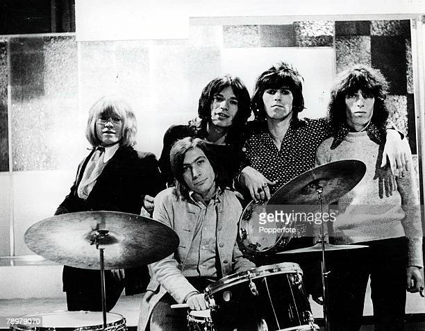 1960's British pop group The Rolling Stones pose for a group portrait They are LR Brian Jones Charlie Watts on drums lead singer Mick Jagger Keith...