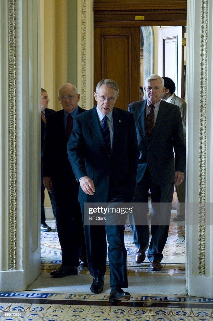 From left, Brig. General John H. Johns (Ret.), Senate Majority Leader Harry Reid, D-Nev. and Lt. Gen. Robert G. Gard Jr. (Ret.) walk from Sen. Reid's office to a news conference on Iraq in the Capitol on Monday, April 16, 2007.