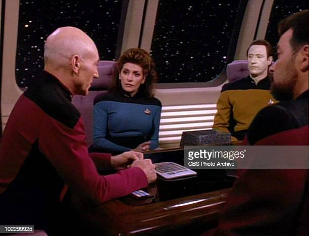 From left British actor Patrick Stewart BritishAmerican actress Marina Sirtis and American actors Brent Spiner and Jonathan Frakes in a scene from...