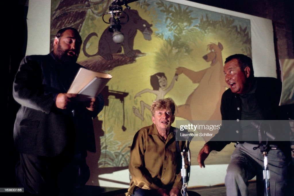 From left, British actor Sebastian Cabot (1918 - 1977) (as Bageera) and American actors Sterling Holloway (1905 - 1992) (as Kaa) and Phil Harris (1904 - 1995) (as Baloo) record voices for the Walt Disney animated film 'The Jungle Book' (directed by Wolfgang Reitherman) in a studio, Burbank, California, 1964.
