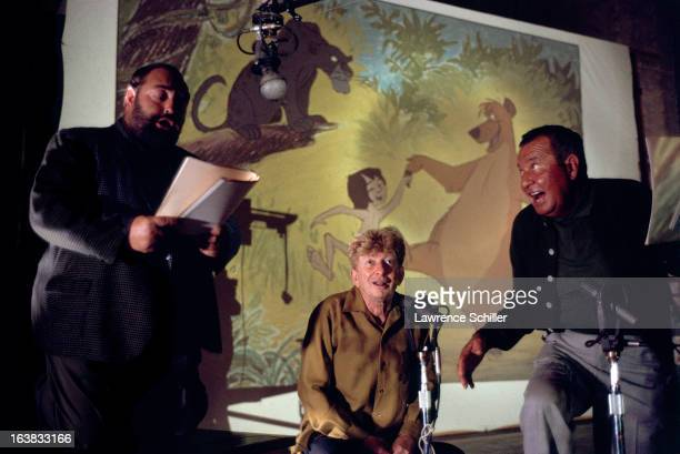 From left British actor Sebastian Cabot and American actors Sterling Holloway and Phil Harris record voices for the Walt Disney animated film 'The...