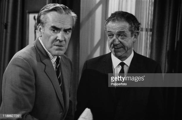From left British actors John Le Mesurier and Sid James dressed in character as Colonel Maynard and chauffeur George Russell during filming of the...