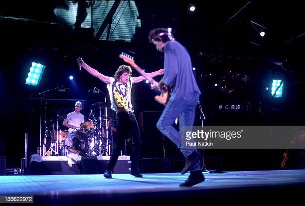 From left British musicians Charlie Watts Mick Jagger and Keith Richards of the Rolling Stones perform on stage during the band's 'Voodoo Lounge'...